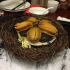 Abalone on a bed of mushrooms served in a nest