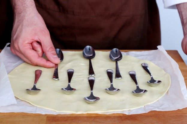 Place small spoons onto the puff pastry sheet