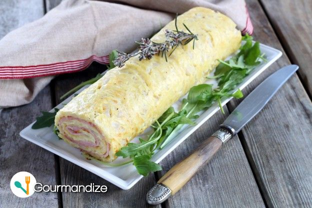 Giant rolled omelet stuffed with ham and cheese