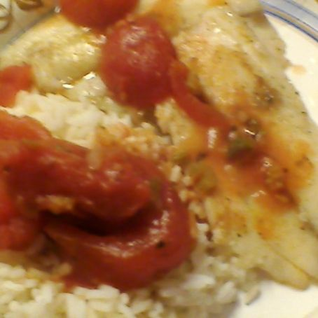 Tilaphia with rice and tomatoes