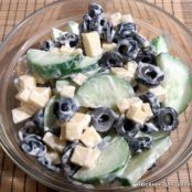 Cucumber salad with olives and cheese