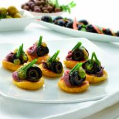 Spanish Corn cakes with tomato and olives